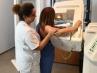 Sanitaria y paciente durante una mamografía