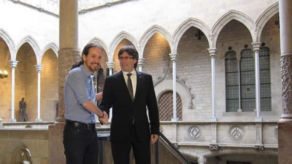 Pablo Iglesias y Carles Puigdemont.