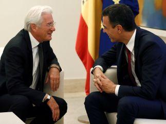 Sonrisa cómplice entre Richard Gere y el presidente