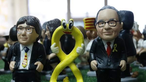 Caganers del president de la Generalitat, Quim Torra, del expresident Carles Puigdemont y del lazo amarillo.
