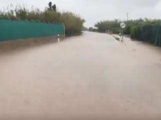 El temporal de lluvia desborda el río Júcar en la desembocadura de Cullera