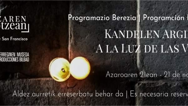 Cartel de la visita con velas en el Museo de Reproducciones de Bilbao