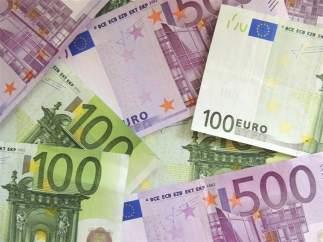Dinero y cajas registradoras
