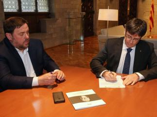 El pte. Carles Puigdemont y el vpte. Oriol Junqueras