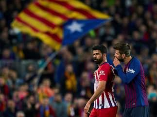Costa y Piqué, tras la expulsión del delantero atlético