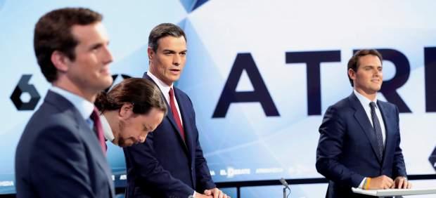 Los candidatos, durante el debate