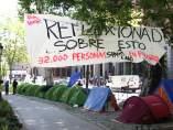 Acampada personas sin hogar en el Paseo del Prado