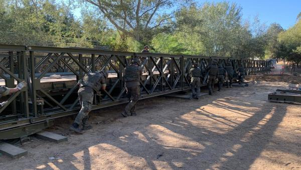 Entrega del puente militar tipo 'Bailey' instalado en el Puente de los Olivarejos para el traslado de la Virgen del Rocío a Almonte