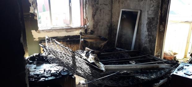 La habitación en la que se originado el fuego en la calle Santa Lucía en Valladolid
