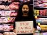 Veganos protestan en un mercado de Auckland en Nueva Zelanda.